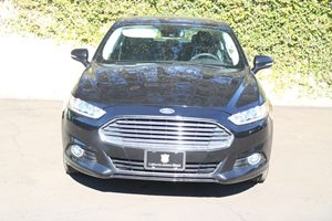 2015 Ford Fusion Energi Titanium  Tuxedo Black All advertised prices exclude government fees an