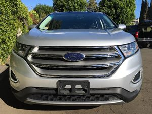 2015 Ford Edge SEL  Ingot Silver Metallic  All advertised prices exclude government fees and ta