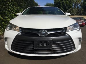 2016 Toyota Camry LE  Super White  We are not responsible for typographical errors All prices