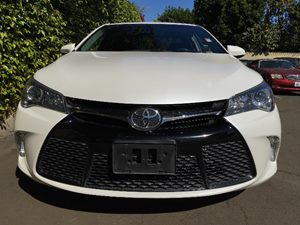 2015 Toyota Camry SE  Super White  All advertised prices exclude government fees and taxes any