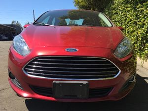 2014 Ford Fiesta SE  Red  We are not responsible for typographical errors All prices listed ar
