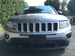 2016 Jeep Compass Sport  Gray  We are not responsible for typographical errors All prices list