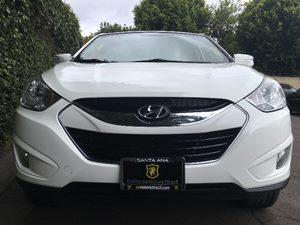 2013 Hyundai Tucson Limited  White  All advertised prices exclude government fees and taxes an