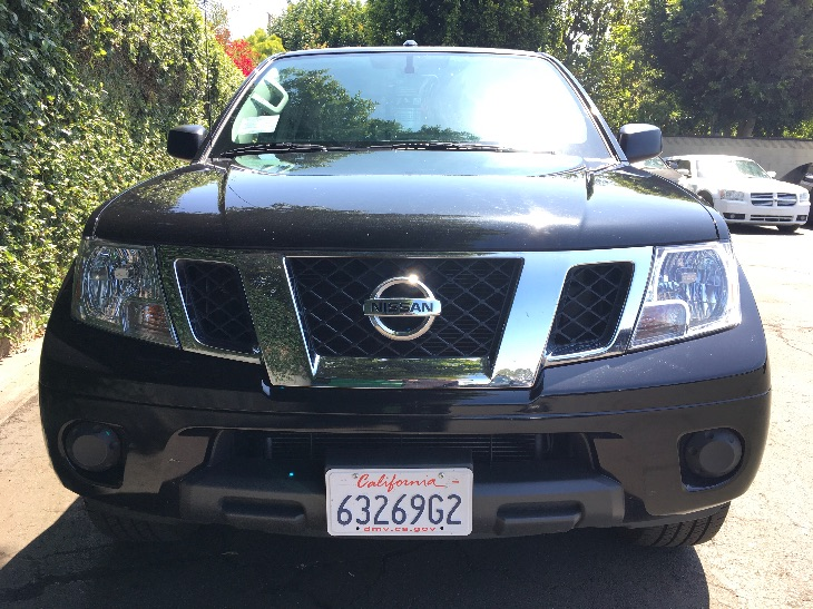 2017 Nissan Frontier SV  Magnetic Black All advertised prices exclude government fees and taxes