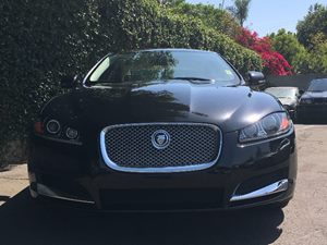 2013 Jaguar XF 20T  Ultimate Black Metallic  All advertised prices exclude government fees and