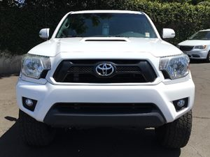 2014 Toyota Tacoma PreRunner V6  Super White  All advertised prices exclude government fees and
