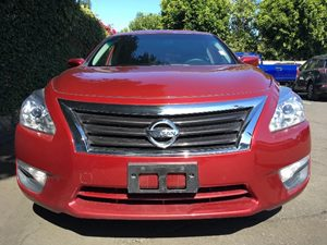 2015 Nissan Altima 25 S  Cayenne Red All advertised prices exclude government fees and taxes