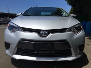 2015 Toyota Corolla LE  Classic Silver Metallic  All advertised prices exclude government fees