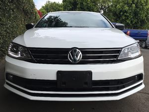 2015 Volkswagen Jetta Sedan Sport PZEV  Pure White  All advertised prices exclude government fe