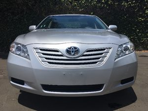 2009 Toyota Camry LE  Classic Silver Metallic All advertised prices exclude government fees and