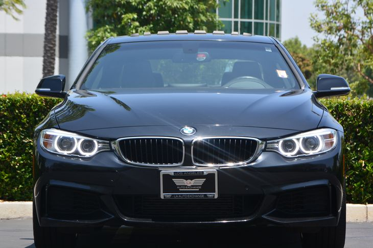 2014 BMW 4 Series 428i  Black Sapphire Metallic All advertised prices exclude government fees a