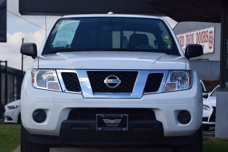 2016 Nissan Frontier SV  Glacier White All advertised prices exclude government fees and taxes