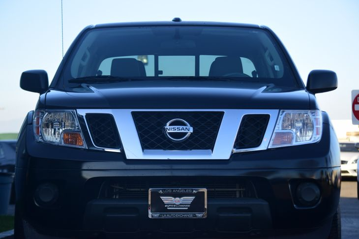2016 Nissan Frontier SV  Magnetic Black All advertised prices exclude government fees and taxes