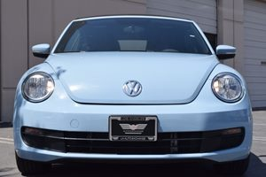 2014 Volkswagen Beetle Convertible 25L PZEV  Blue  We are not responsible for typographical er