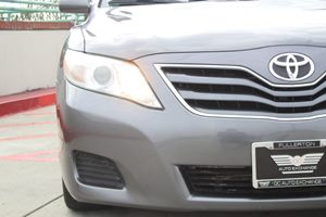 2011 Toyota Camry LE Carfax Report  Magnetic Gray Metallic  We are not responsible for typogra