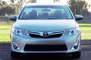 2014 Toyota Camry XLE Carfax 1-Owner  Gold  We are not responsible for typographical errors A