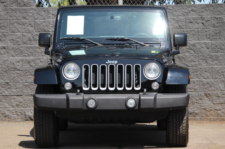 2016 Jeep Wrangler Unlimited Sahara  Black Clearcoat All advertised prices exclude government f