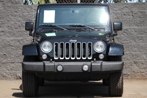 2016 Jeep Wrangler Unlimited Sahara  Black Clearcoat  All advertised prices exclude government
