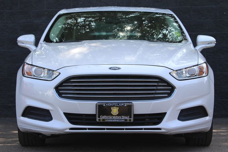 2014 Ford Fusion SE  White All advertised prices exclude government fees and taxes any finance
