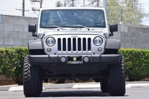 2014 Jeep Wrangler Unlimited Sport Carfax 1-Owner - No AccidentsDamage Reported  Gray  We are