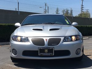 2006 Pontiac GTO  Carfax 1-Owner - No AccidentsDamage Reported  Quicksilver Metallic  We are