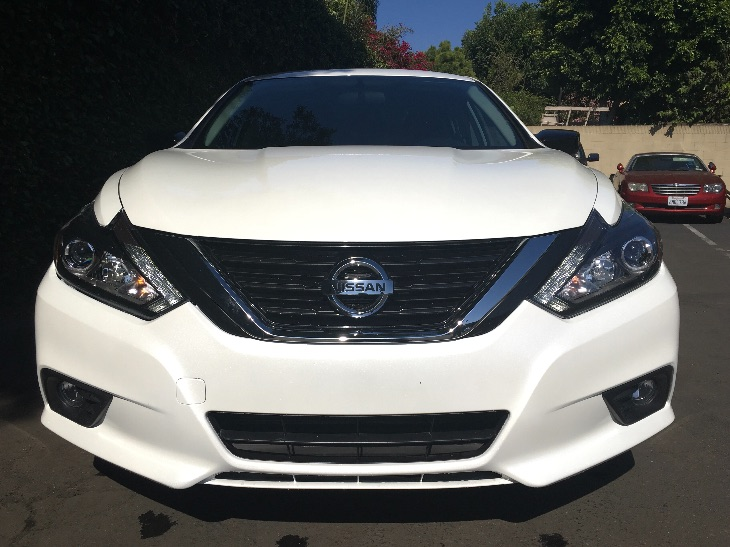 2017 Nissan Altima 25 SR  Pearl White All advertised prices exclude government fees and taxes
