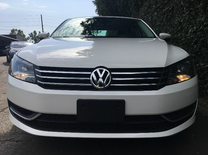2014 Volkswagen Passat SE PZEV  Candy White All advertised prices exclude government fees and t