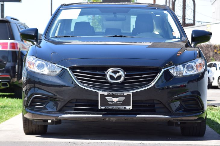 2015 Mazda Mazda6 i Touring  Jet Black Mica  All advertised prices exclude government fees and