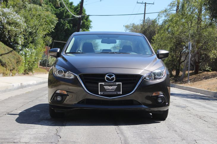 2016 Mazda Mazda3 i Touring  Jet Black Mica All advertised prices exclude government fees and t