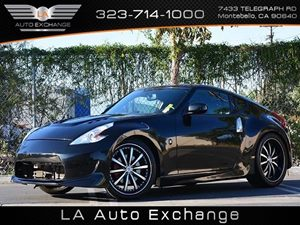 2013 Nissan 370Z Touring Carfax 1-Owner  Black Cherry Metallic  All advertised prices exclude