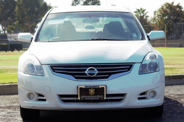 2012 Nissan Altima 25  White All advertised prices exclude government fees and taxes any fina