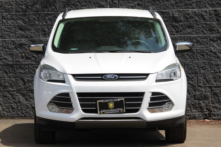 2015 Ford Escape SE  White All advertised prices exclude government fees and taxes any finance